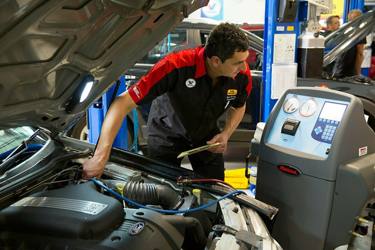 mechanic checking computer by Auto Masters